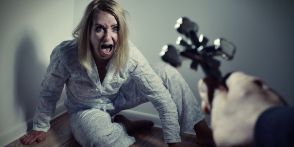 web3-cross-exorcism-exorcist-demon-woman-shutterstock_431930608-itsmejust-ai